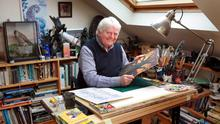 Don Conroy in his studio at his favourite desk where he does all his artwork