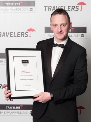 Anthony Rath of John A Sinnott Solicitors collecting the award