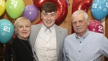 Shane Murphy at his 21st with his parents Catherine and Pat