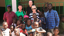 Fr Tom Dalton, Keith Jordan and Catherine Jordan with locals at The Kitty Clinic