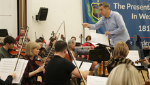 Liam Bates conducting the Wexford Sinfonia during a rehearsals session at the Presentation School