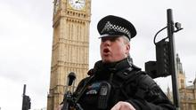 Armed police respond outside Parliament during the incident on Westminster Bridge in London.