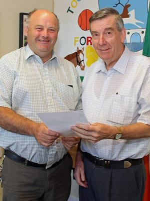 Denis North (right) is congratulated on his results by the vice principal of New Ross Vocational College, Dominic Hearne.