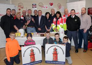 Des Murphy launched Rosslare Harbour First Responders fundraising drive in Murphy's Supervalu. Pictured were (back row) Cllr Ger Carthy, Jason Connery, Josie Meyler, Bill Sutton, Chris Dowling, Peter McDaid, Des Murphy, Shirley Bolger, Paul Ironside, Elaine Dowling, Kevin MacCormick, Anthony Byrne and Richard Gleeson. Front: Louis McDaid, Lily McDaid, Liam Holden, James Holden and Sean Holden