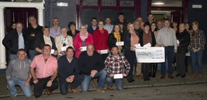 Members of the Castle Vintage Club present cheques to local groups outside The Cuckoo's Corner in Taghmon