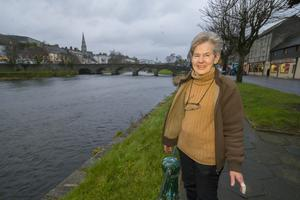 Local businesswoman Diana Shiel on the banks of the Slaney in Enniscorthy, which will receive additional funding for flood defences. Photo: Patrick Browne