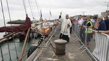 Fr James Cullen blessing the boats at Wexford Quayfront earlier this year