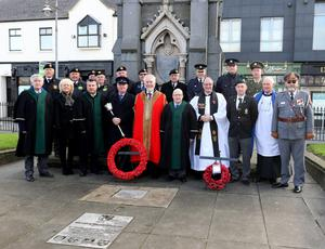 above: Attendees at the wreathlaying to honour Wexford's war dead in Redmond Square. left: Mayor of Wexford Jim Moore lays a wreath at the memorial.