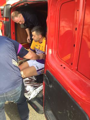Richie Kehoe being assisted out of the van by Faythe Harriers trainer Dave Guiney