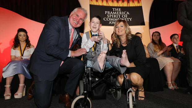 Above: Sophie receiving her 2015 Pramerica Spirit of Community Award from Brent Pope and Andrea McBride, Vice President - Systems, Pramerica Systems Ireland and right Nathan receiving his award.