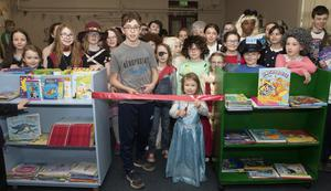 Youngest pupil Leah Sinnott and eldest pupil John Rochford cut the tape to open the new library at Kilmore National School