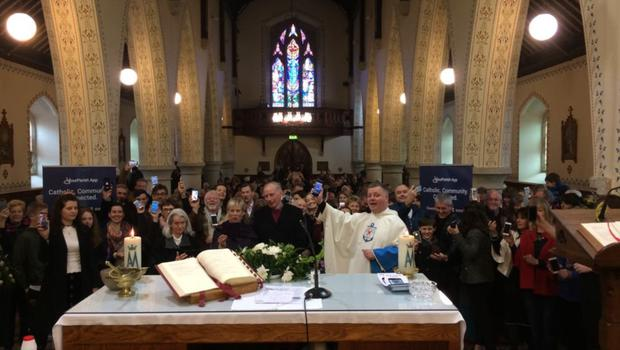Parishioners at Barntown Church downloading their new parish app at the Easter weekend Masses in Barntown