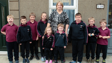 Caroline Kearney of 110 The Faythe with her nine grandchildren, all who go to the St John of God School The Faythe, Alfie Kearney, Luke Murphy, David Kearney-Phillips, Eva Kearney, Ciara Louise Murphy, Mason Kearney-Phillips, Ryan Murphy, Dylan Murphy, Lauson Kearney-Phillips
