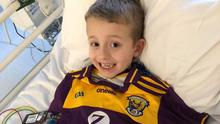 Tommy sporting the brand new Wexford jersey in hospital