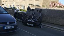 The overturned car at Davitt Road South