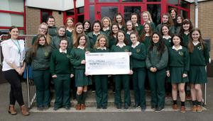Transition Year students at the Presentation, and teacher Jackie Hartnett present the cheque for €950.21 to Mary O'Connor of the Irish Wheelchair Association