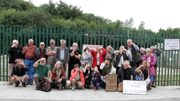 Protesters from the local area outside the proposed site of the waste water plant.