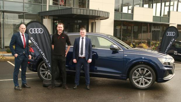 Stephen Redmond, Audi sales; Barry Devereux, Audi marketing and Kris Murphy, Audi sales with the Q8 at the Hatch Lab in Gorey