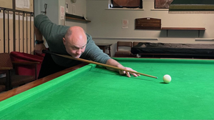 Alan Ennis trying out his new cue
