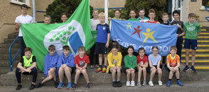 The Green Flag and Active Flag committees with teacher Fiona Hudson and school principal Caroline Delaney at the raising of the St. Iberius National School's first Active School Flag and their fifth Green Flag