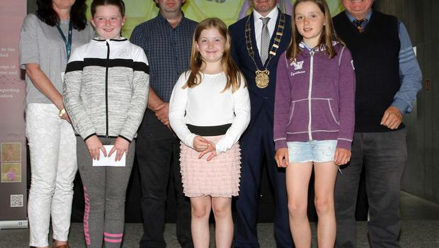 3rd and 4th Class winners, back row: Cliona Connolly, Wexford County Council; Eabha Doyle, Scoil Naomh Maodhóg Ferns; Nicholas Egan Wexford Naturalists Field Club; Elese Doyle, Ballyduff NS; Cllr John Heagarty, Ava Doyle for Hannah Willis, St Kevin's NS Tara Hill and Don Conroy, artist and judge.