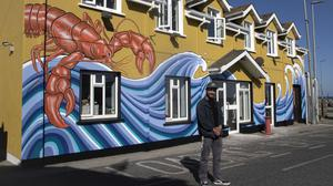 Nirman Kadel with his amazing new mural painted on new venture Quayside in Kilmore Quay