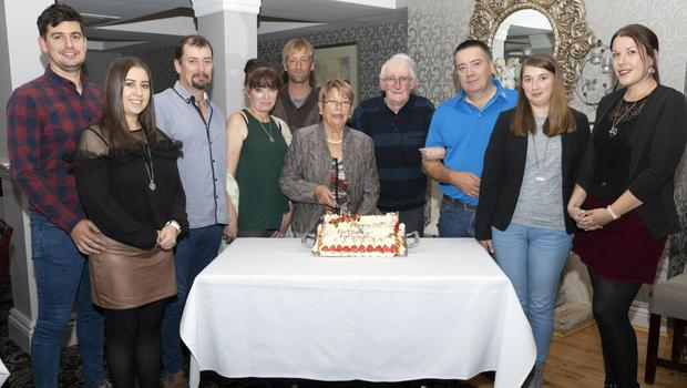 Kathleen Saunders from Liam Mellows Park with her husband Amby and their family at her 80th birthday celebrations in the Whitford House Hotel