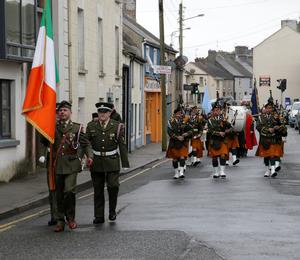 The 3rd Battalion Irish Defence Forces and the New Ross FCA Pipe Band leading the parade