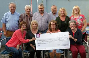 The Tullicanna Fundraising Committee presented a cheque for €3946.75 to South Wexford MS. Pictured, at the back,from left, were: Rich Stafford, Dick Tobin, Jim White, Nicky Carthy, Ellie Carthy and Mary Hawe; (Seated) from left: Mairead Nagle, Ruby Murphy, Brid White and Bernie Faragher