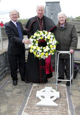 Back in 2013, Bishop Denis Brennan led the annual service and wreath laying ceremony at the memorial garden Kilmore Quay. Pictured were Jim Power, Bishop Denis Brennan and Sam Williams who lost six of his friends on the FF Isolda when it was torpedoed