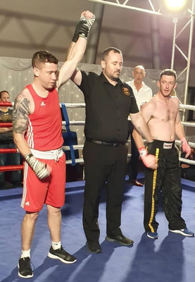 Lar is declared winner after his fight in Clayton Whites Hotel