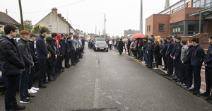 Students line the route as popular teacher Sinead makes her final journey on Friday