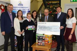 At the presenation to three schools in Roche Frieight: Conor Roche; Annie Breslin,Tagoat NS; Danny Howlin from Kilrane NS who won the Christmas card design competition for the school; Ann Marie Carthy, principal, Scoil Mhuire, Rosslare; Eoin O Donagain, principal, Kilrane NS; Damien Roche; and  Clare Geoghegan, Prim-Ed.