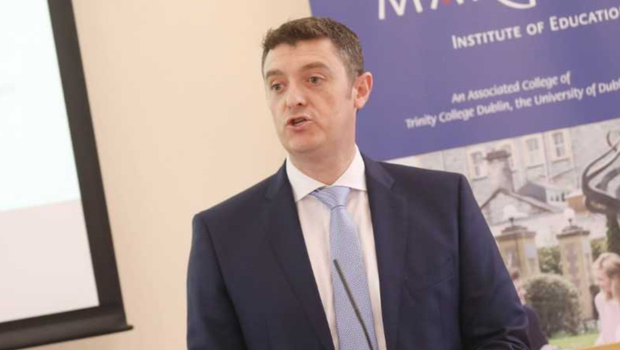 Dr Rory McDaid speaking at the first graduation ceremony