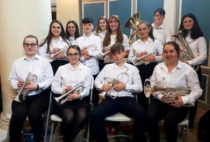 The youth band. Back: April Keeling, Karen Roche and Michael Day. Middle: Muirrin Carty, Enda Morgan, Emma O'Leary, Eabha Carty and Emily O'Reilly. Front: Aislinn O'Sullivan, Caitlin Carty, Matthew Day and Amy Clancy.