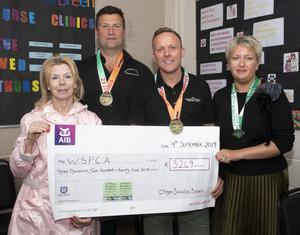 O'Shea, Bramley and Breen Veterinary Hospital present the cheque for €3,249 to the WSPCA (from left): Bridget Cullen (WSPCA), Richard Bramley, Martin Breen and Michelle Mernagh