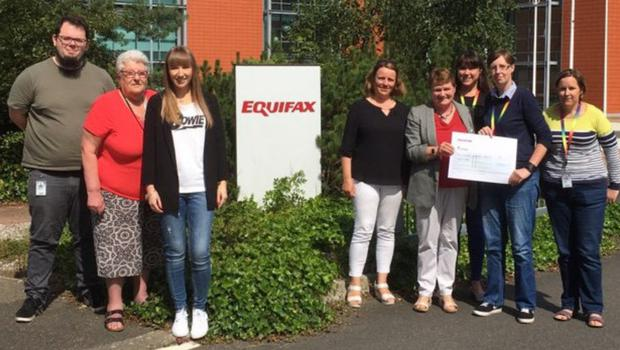 Equifax committee members present a cheque to the Wexford Mental Health Association