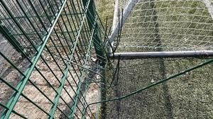 Some of the damage to the fencing at Bridge Rovers' facilities