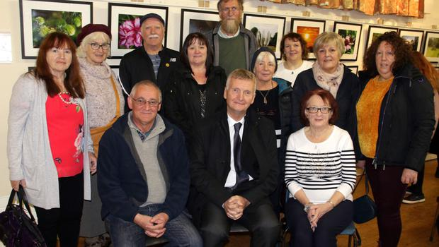 Exhibitors with Alan Corcoran, who opened the exhibition, back – Colleen Nolan, Mary Fitzpatrick, Danny Conway, Margaret Creane, Colm O'Muiri, Maria Mahon, Maria Howlin, Stella Doyle and Susan Goodison; seated – Tony Doyle, Alan Corcoran and Kathleen Fitzpatrick