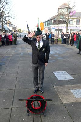 Mark Ross of the Royal Irish Rangers laying  a wreath at the Redmond Square memorial.