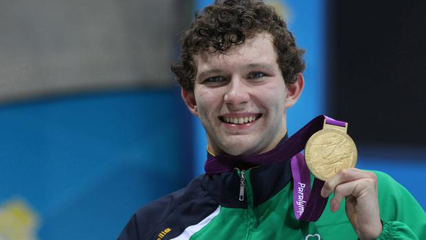 1 September 2012; Ireland's Darragh McDonald, from Gorey, Co. Wexford, celebrates with his gold medal after winning the men's 400m freestyle - S6 final. London 2012 Paralympic Games, Swimming, Aquatics Centre, Olympic Park, Stratford, London, England. Picture credit: Ian MacNicol / SPORTSFILE