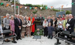 Members of Robert Brennan's family with local dignitaries at the unveiling of the monument.