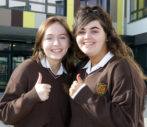 A thumbs-up from Hannah Philpott and Sophie Murray on their first day in the new school