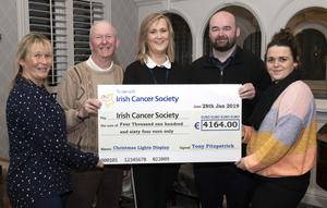 Tony Fitzpatrick from Drinagh presented a cheque to The Irish Cancer Society. L/r; Catherine Casey, Tony Fitzpatrick, Carmel Murphy (Irish Cancer Society), David Fitzpatrick and Victoria Browne
