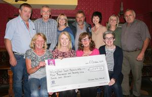 The Tullicanna Music Festival organisers presented a cheque of €4079.32 to Wexford South Branch MS. Back row: John Cullen, Frank Farrell, Mary Hawe, Jim White, Mairead Nagle, Jean Cullen and Nicky Carthy. Seated: Ellie Carthy, Ruby Murphy (MS Wexford), Brid White and Bernie Faragher