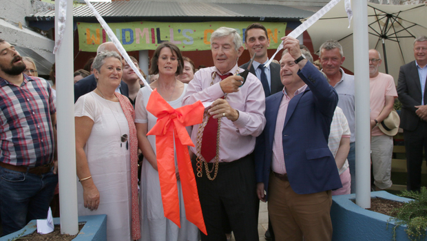 The Mayor cuts the ribbon with a little help from Brendan Howlin
