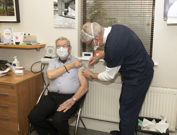 Dr David Curtis administers the Covid vaccine to his 92 year-old father Dr Bart Curtis