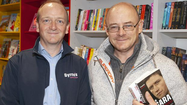 Bookshop proprietor Damien Byrne with Mike Nagle at the reopening.