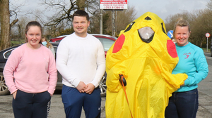 Eamonn Mernagh of Mernagh's Bar, Oylegate (in Pikachu costume) with his wife Sue and children, Hannah and Eddie