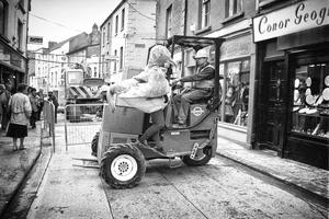 1994: Main drainage works on Wexford's South Main Street, as 'the goose' – the mascot of a PR campaign promoting 1994 the message, 'We're sorry, but it'll be worth it' – hitches a ride. Picture by Padraig Grant